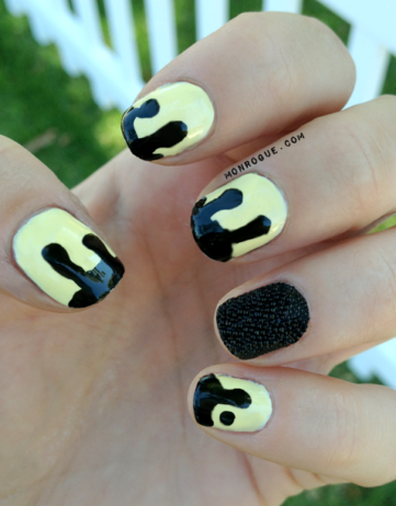 Dripping Black on Yellow Nails with a Caviar Accent!